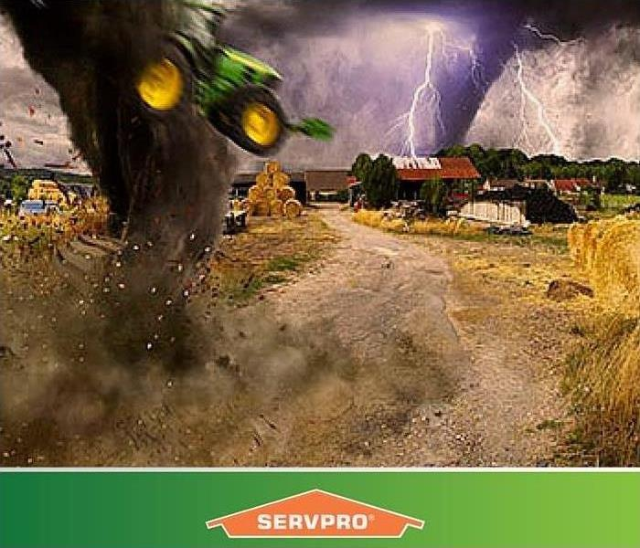 Storm causing damage to land. Tornado lifting a tractor in the air.