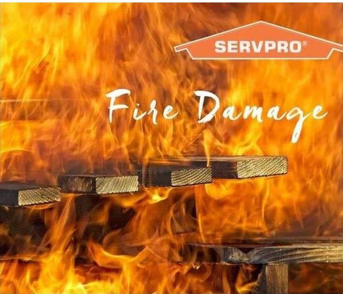 Fire burning wood structure with a SERVPRO logo on the top right corner.